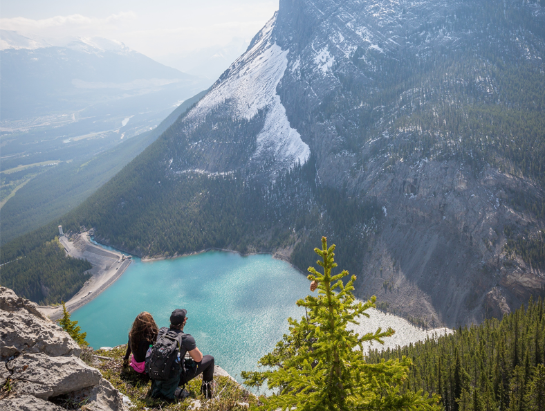 image of two mountain hikers resting