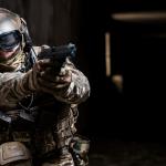army aiming gun