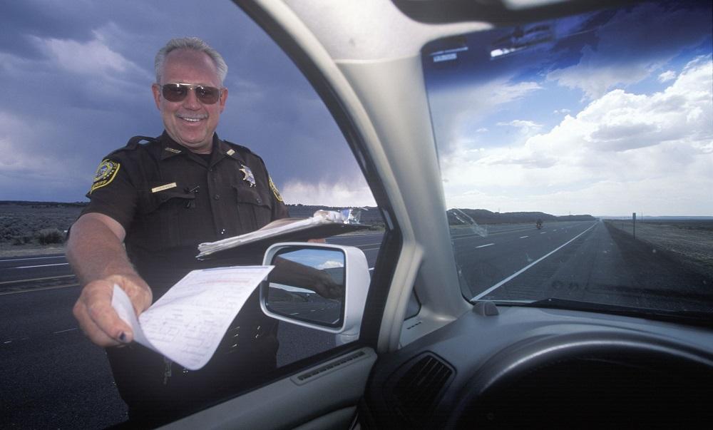 highway patrolman gives a speeding ticket