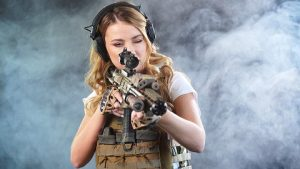 young woman wearing tactical gloves